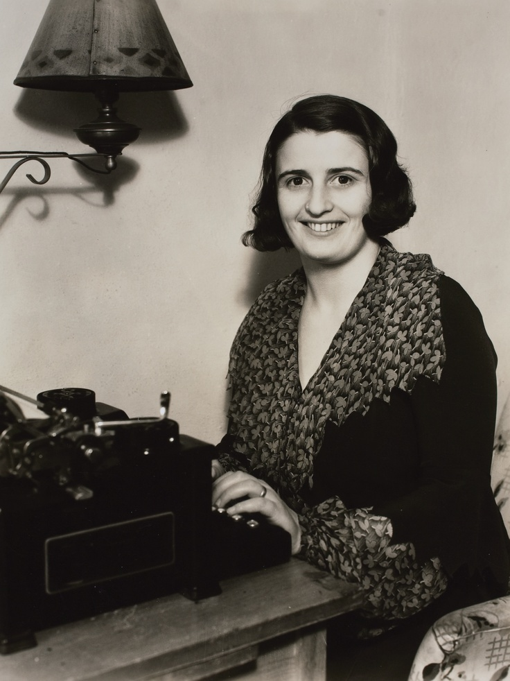 Ayn Rand | c. 1930s, Hollywood, CA | Ayn Rand seated at her desk. The desk was a gift from her husband Frank O'Connor.