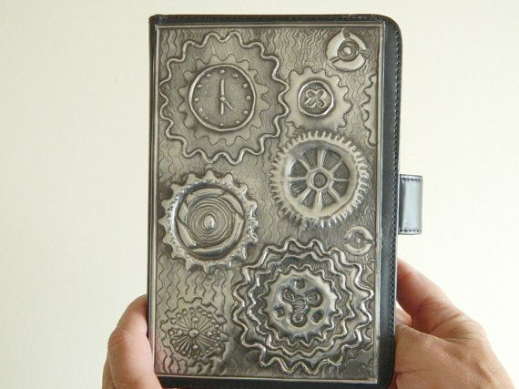 A Black Faux Leather Cover Case for Kindle 3 and 3G with a steampunk pewter embossed design. An ideal gift for Fathers Day. The case is professional looking and top quality    Slot your Kindle into one side and it has a document pouch on the other side as shown on photo. It has a secure magnetic closure system and allows access to controls and ports    I can make this design for other Kindle models. Ideal gift for anyone with a Kindle. Make an ideal gifts for men or for women.