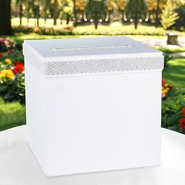 White satin card box with white satin ribbon and beautiful, sparkling faux rhinestone thick panelling around all four sides and the cared slot.  Slotted lid opens for retrieving cards.  Measures 25.5cm x 25.5cm x 25.5cm - The Wedding Faire