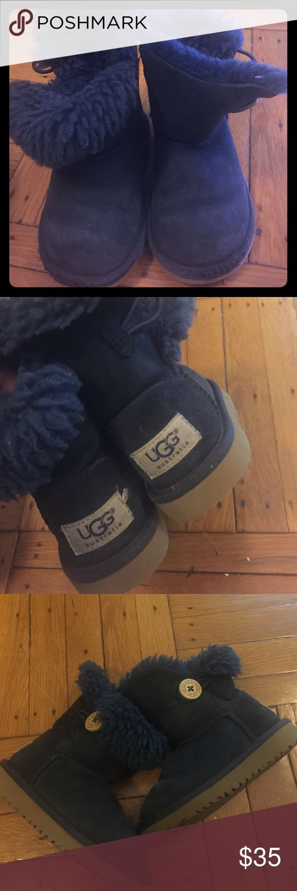 Kids navy blue uggs Kids navy blue uggs. Still in good condition but  has some scraps in the front from my daughter playing on her knees all day! Price to go! UGG Shoes Boots