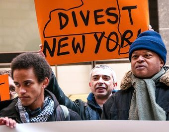 2014: Riding a Rocket, Divestment Movement Gains Momentum |The notion that most of the fossil fuel reserves on company balance sheets must stay in the ground—stranded—is no longer unthinkable |Photo: Activists from the group 350.org protest outside the New York State Comptroller's office in Manhattan in March 2014 urging divestment from fossil fuels. Credit: Adam Welz