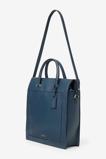 Over Carrying 2 Bags To Work? So Are We... #refinery29  http://www.refinery29.com/best-bags-for-laptops#slide13  Hold this one in your hand or sling it over your shoulder.