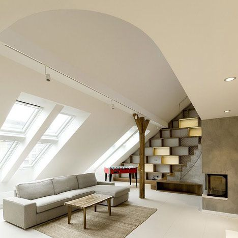 A1 Architects converted the former attic of an apartment block into a two-storey residence