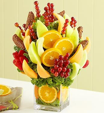 wouldn't it be cool to have a fruit bouquet at the reception table instead of flowers and ppl can pick what they want and enjoy while they wait for their meal! just an idea :)