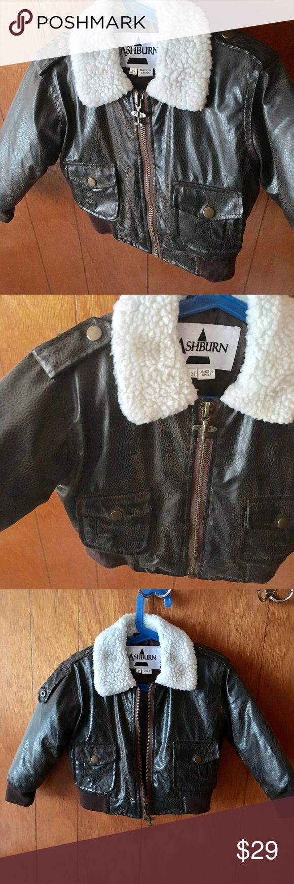Faux Leather Toddler Bomber Jacket Great condition 3T Toddler Bomber jacket! Dark brown faux leather. Full zip with airplane zipper. Soft off white collar. Polyester fill. Machine washable. No cuts in the leather. Slight pilling starting on the cuffs and waistband but I can easily get that off before shipment. Ashburn Jackets & Coats