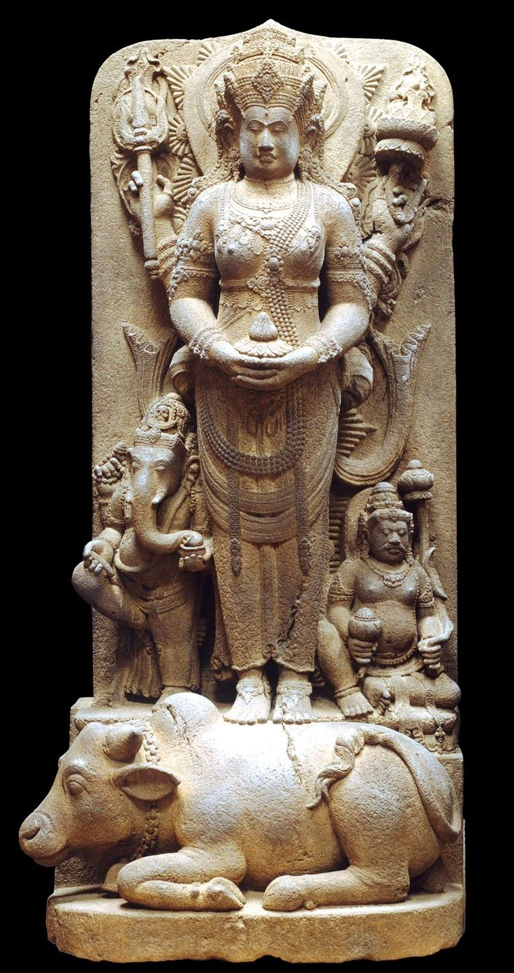 Posthumous Portrait of a Queen as Parvati, standing on Shiva's vehicle, the bull Nandi, and flanked by her two children; 14th century,  Eastern Javanese period, Java,  Indonesia. @ The Metropolitan Museum of Art, New York