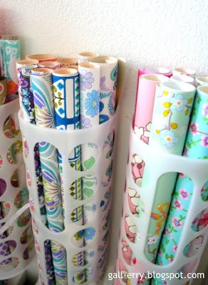 Organizing gift wrap using plastic bag holder from Ikea.