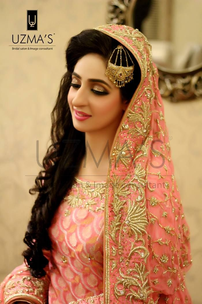 Stunning Walima bride flaunting our Signature line makeup. Gold smokey eyes with a tinted pink lipcolor, Makeup by uzma's beauty salon