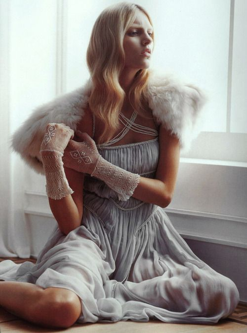 Feminine beauty: Silk grey gown + fur stole.