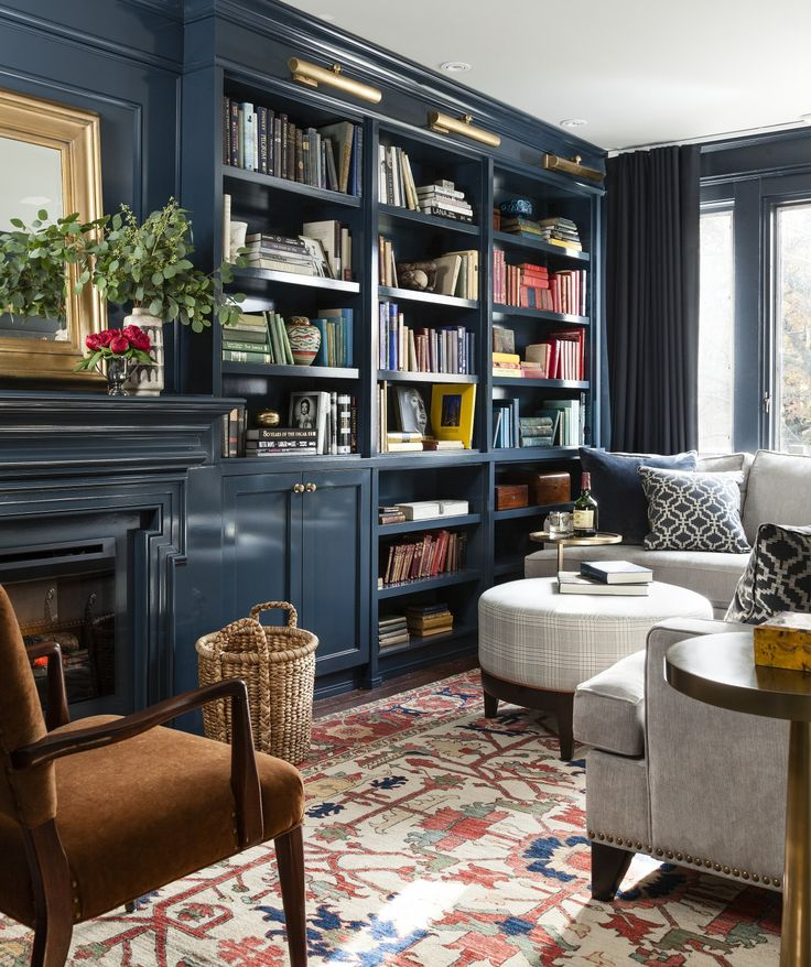Navy walls with built-in bookshelves and orange boho rug | Meredith Heron