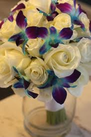 White roses and blue orchids.