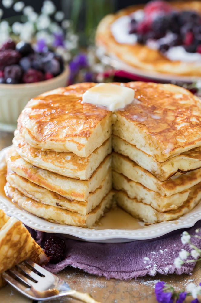 I've got breakfast covered today with these classic Buttermilk Pancakes -- made completely from scratch! These pancakes are thick, fluffy and are so easy to make! Try them out for yourself and you'll never be satisfied with pancakes out of a box again! One of the biggest benefits of being homeschooled growing up was that most mornings I could count on having my math problems interrupted by a giant stack of freshly cooked, completely from scratch, buttermilk pancakes.