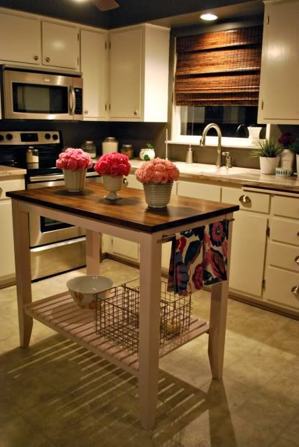 kitchen island - if I did a table or something like this (and had no where else to hang the pots) I'd chop off the bottom and hang the pots under the island.  Easy access.