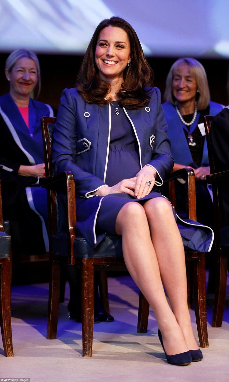 The Duchess, dressed in head to toe blue, breaks into a smile as she watches a presentation at the RCOG today. The 36-year-old royal learned about the college's global health programme during her visit on Tuesday
