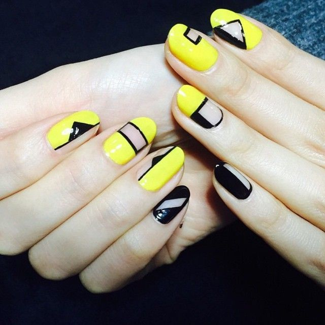 Black and yellow negative space nail art