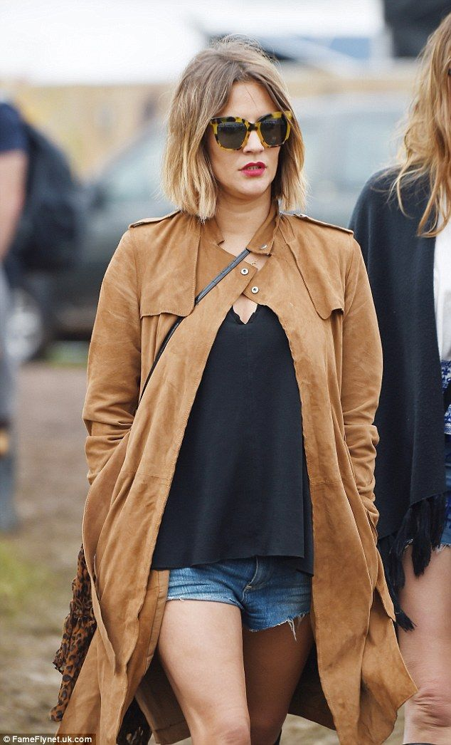 Stylish: Caroline looked fabulous as ever in a suede coat and denim cut-offs as she enjoye...