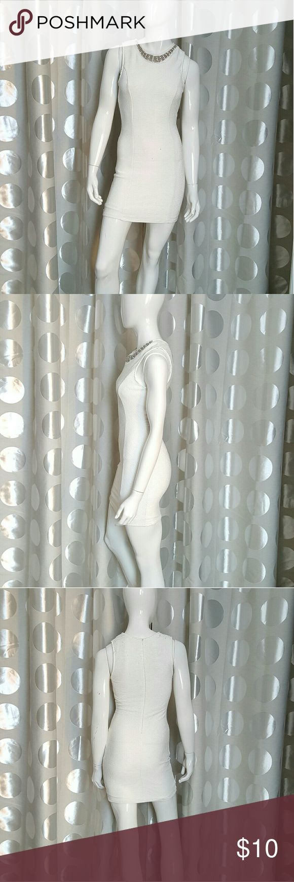Charlotte Ruuse White Dress This dress is comfortable and not see through.  There are a couple of small drops of wine on it that you can maybe get out as seen in 5th photo.  I never tried. Used only once.   Very nice and elegant dress.  Zips up in the back. Charlotte Russe Dresses Mini