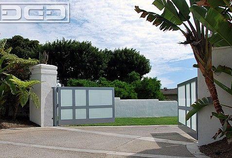 Custom Designed, Modern Glass and Metal Garage Doors & Driveway Gates | Dynamic Garage Door Projects