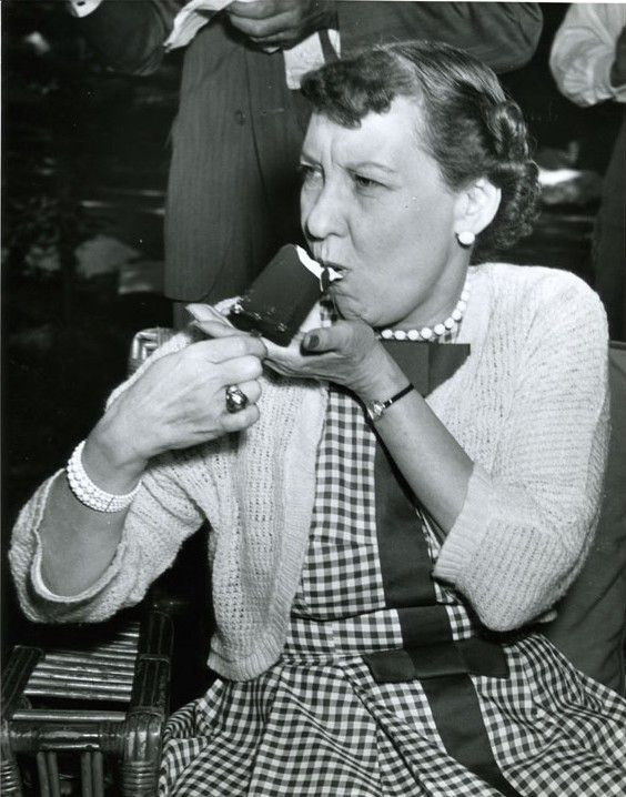 First Lady Mamie Eisenhower enjoying a Good Humor ice cream bar in 1955.