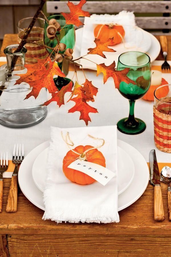 Fall Decorating Ideas: A neutral backdrop of white linens and dishes puts the focus on punches of orange and green.
