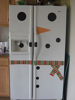 Can't go out because of the storm, make a snow man on the fridge