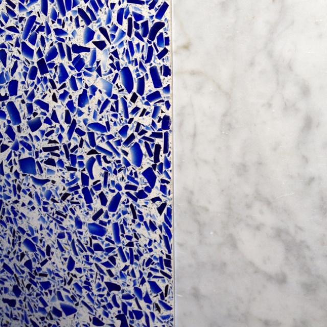 Glass/concrete counters w/ cararra floor/bath tiles