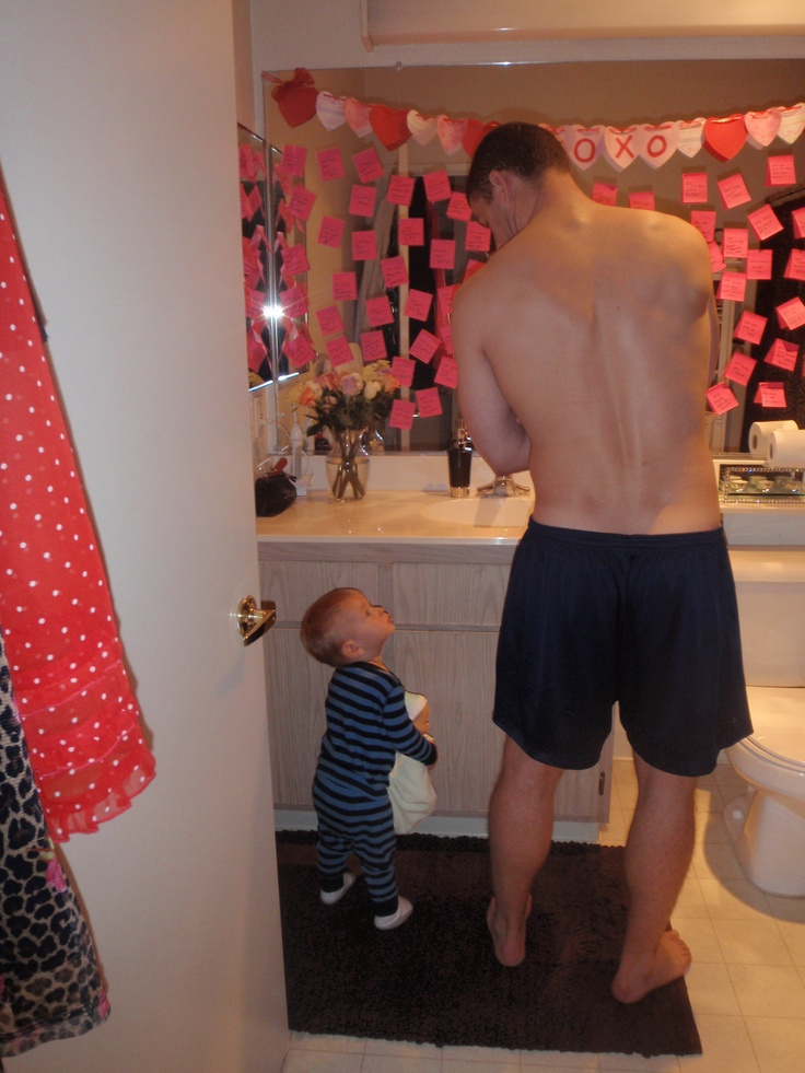 (Execuse my husband without his shirt) I did this for Valentines Day 2 yrs ago.. I posted Post-its ALL over the mirror... Letting him know WHY I loved him <3 He was explaining it to our son:)