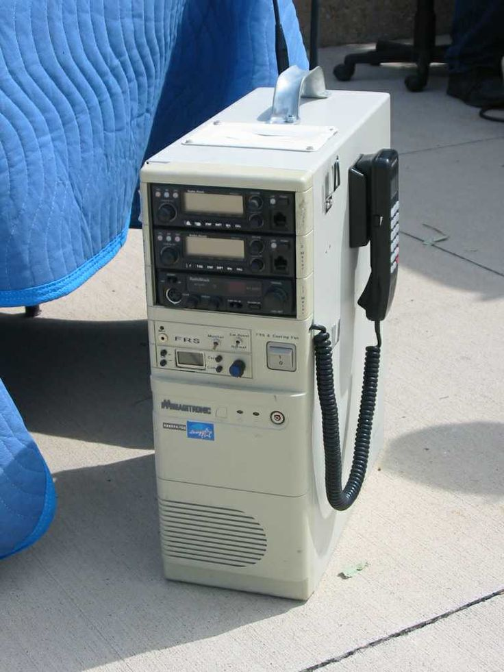 Portable unit made from an old PC case houses several radios and a cellphone. A gel-cel and charger is built into the bottom of the case. It weighs about 20 lbs.