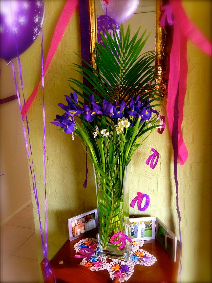 Purple and pink birthday decorations with Iris, alstroemeria and palm leaves … and loads of helium balloons! Photos & decorations by Eleena www.missbloomfields.com
