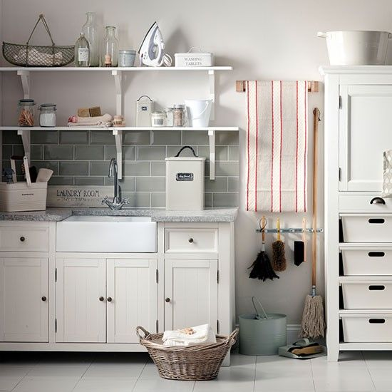 Accessories and storage boxes in a similar colour palette gives this space a lovely unified, elegant feel