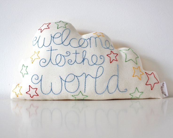 Her store has so many cute things! How sweet would this be to accompany a baby shower gift?  Cloud Cushion Hand Embroidered with Welcome to the World MADE TO ORDER. £25.00, via Etsy.