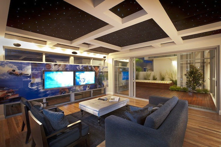 Riverstone Palais entertainment room with LED ceiling detail and Image Ink printed glass feature wall