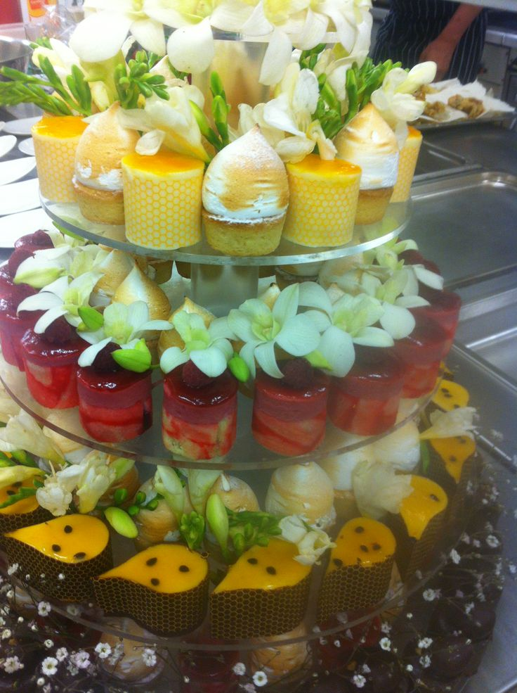 Opulent dessert buffet with a cascading tiered petit four centrepiece