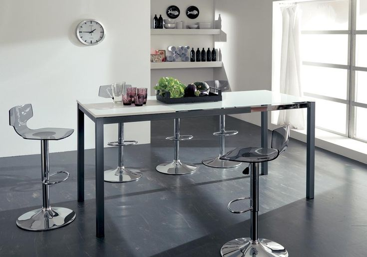 KITCHEN UP. An informal table with an ideal height suitable for breakfast hour, snack time, lunch…it is comfortable also for cooking lessons. Extending dining table with telescopic mechanism, metal structure, eco wood or glass top. http://www.easy-line.it