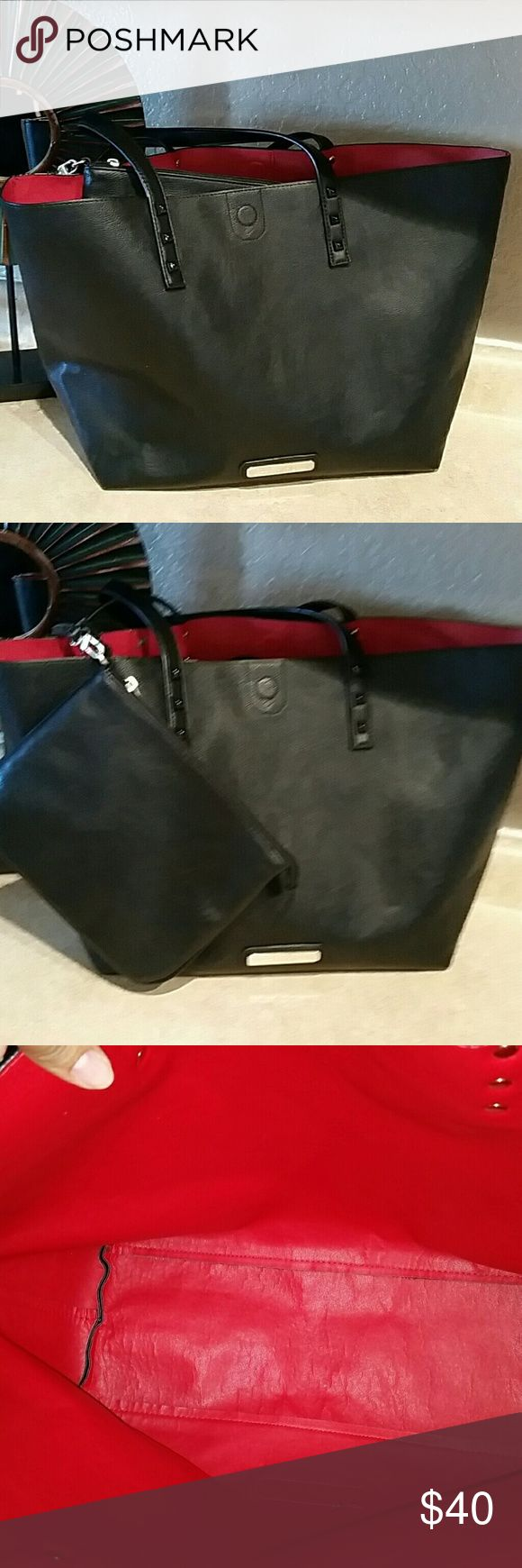 "Olivia + Joy tote bag NWT. Olivia + Joy large black tote bag with bonus black wristlet zip pouch. Has magnetic closure.  12""H 12.5"" bottom W 20.5"" W top of bag 5.5"" D Wristlet is 9""?7"" Olivia + Joy Bags Totes"