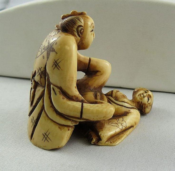 Antique japanese hand carved netsuke depicting erotic scene measures