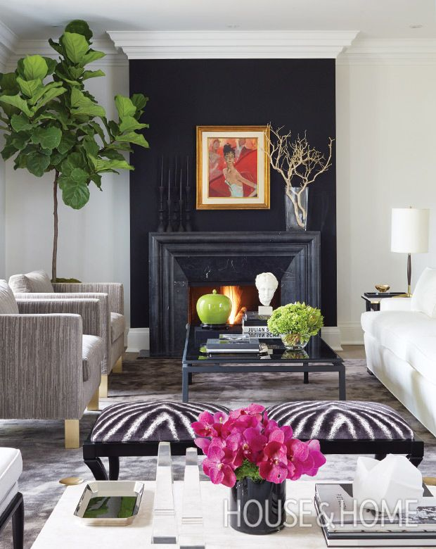 In Sloan Mauran's living room, a painting that's been in Sloan's family for years takes center stage on a bold black wall. | Photographer: Virginia Macdonald
