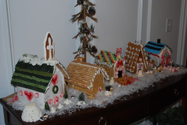 Each member of our family makes their own gingerbread house for our village. Noah was 5, Madison was 12, Dillon was 14. I bake the houses and they choose what to decorate with. Cereal, pretzels, fondant, and candies. We also make little snowmen and penguins out of sugar paste to set around the village. Gumdrop trees and a little fake snow sprinkled around.