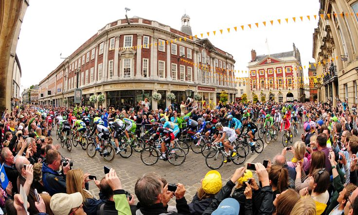 July 6, 2014. The peloton passes Bettys Cafe Tea Rooms in York as stage two of the Tour de France Yorkshire Grand Depart gets under way.