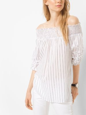 Capture the season's relaxed yet refined mood in our breezy peekaboo top. Smocked detailing lends an artisanal finish, while its striped print…