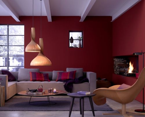 Warm red is cosy and stimulating. Contrasting light neutral tones make this room modern and relaxed. This scheme introduces a warm purple to blend with the red creating interest. Tip- When selecting a bold colour try using a lighter tone of the same colour or a colour next to it on the colour wheel for a more interesting result.