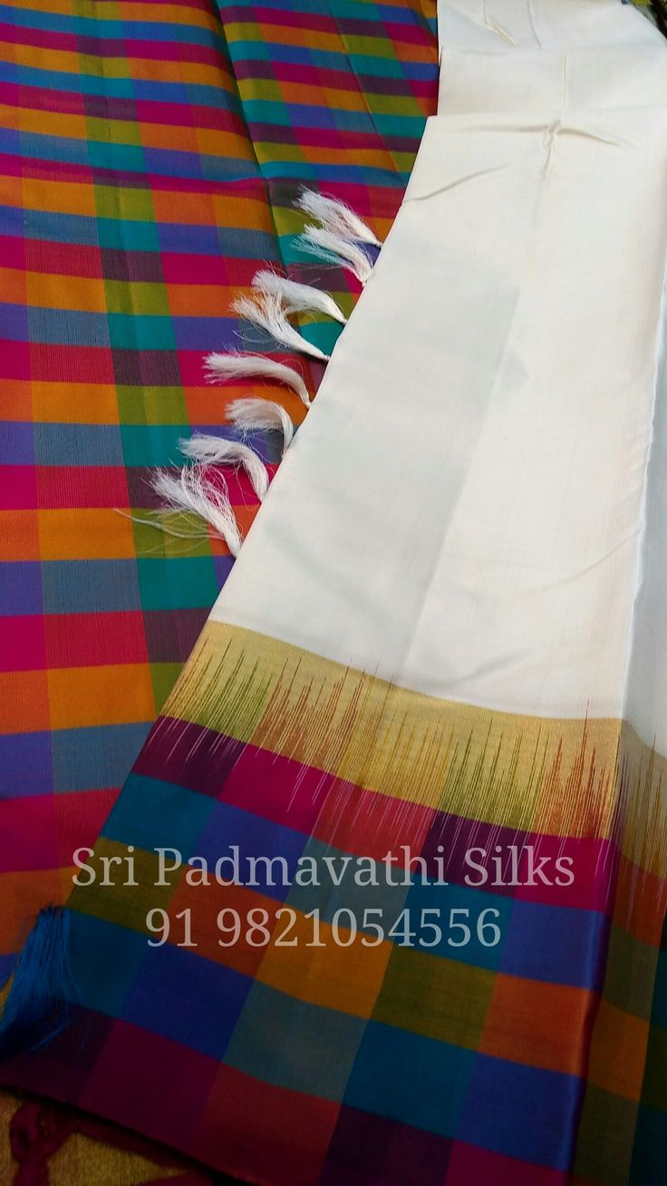 Kancheepuram pure silk sarees with multicolour checks on border, pallu, and blouse. Book now 91 9821054556 Sri Padmavathi Silks, the only south Indian store in Dombivli, India. Kancheepuram pure silk sarees in Mumbai. Online shopping and International shipping available. Wholesale orders accepted.