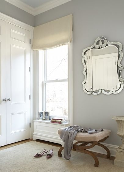 closets - blue gray walls mirror ottoman oatmeal linen roman shade Gray dressing room design with gorgeous gray blue walls paint color, mirror,