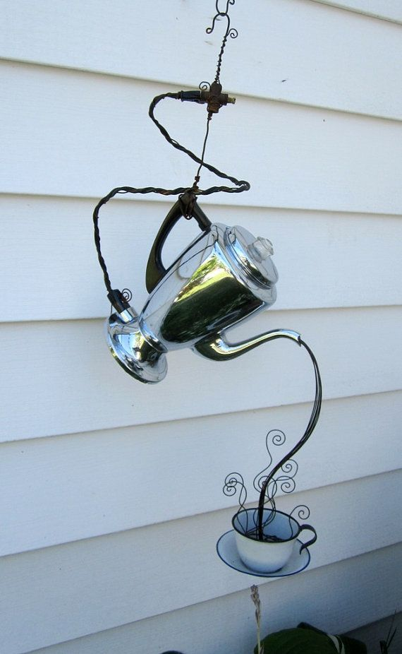 Vintage coffee urn and tea cup garden art