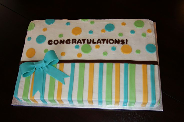 Congratulations on Baby Boy - This was a quick sheet cake I did for an office baby shower.  Simple but I think it came out cute.  Inspiration was taken from another cake here on CC.  Lemon chiffon cake with raspberry filling and lemonade buttercream icing.  Decorations are MMF.