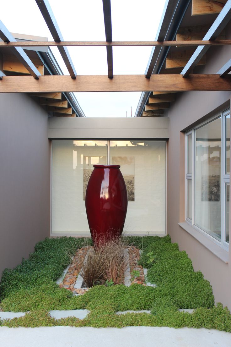 The red look so good the garden ! one amazing contemporary design