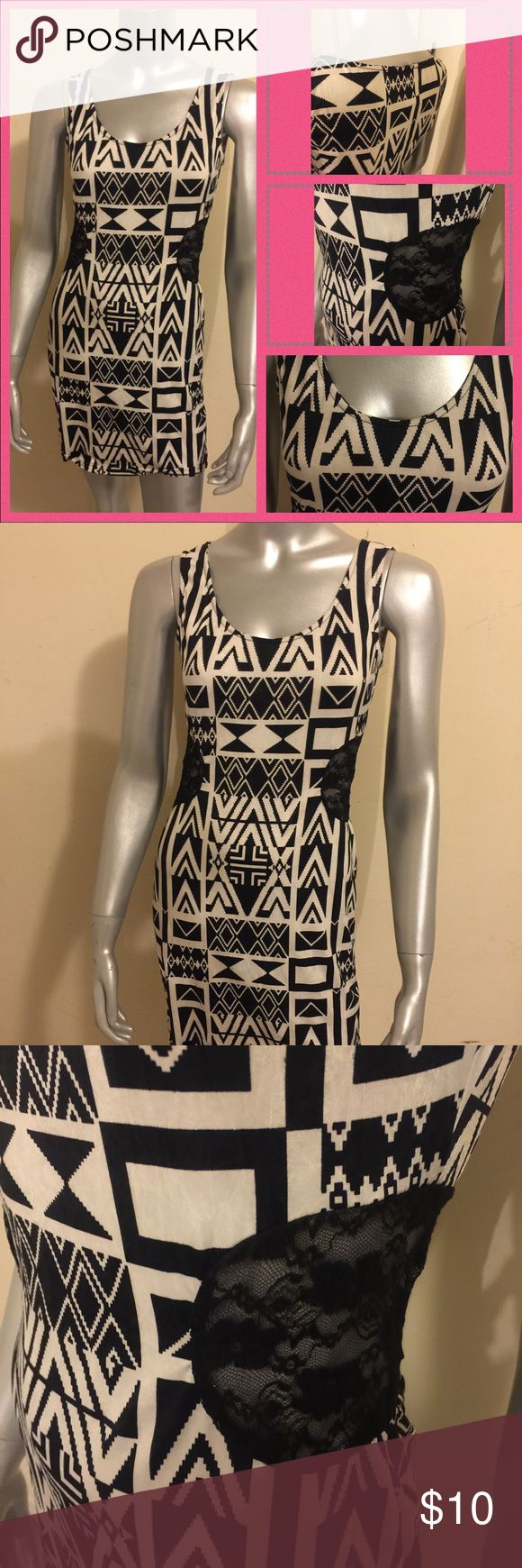 Black & White Pattern Dress Soft polyester material. Side cutouts. No zippers. Stretch material. Size L, but will fit a size medium. Dresses