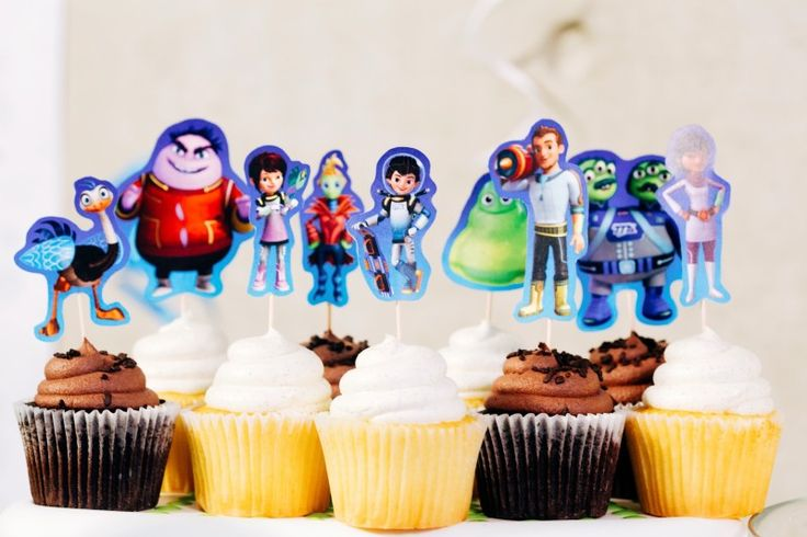 Give homemade or store-boughtcupcakes a galactic twist with printable Miles from Tomorrowland cupcake toppers!