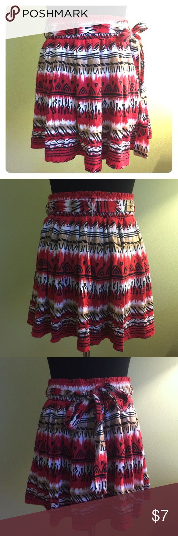 💯 Cotton tribal print skater mini skirt S 100% cotton flowy mini skirt by XXI. Red, brown, white and black tribal designs. Measures 14 inches long. Super comfy and stretchy. Detachable belt you can tie any way you want. Perfect for layering. Worn once. Excellent condition. Not F21 - tagged for similar style exposure. BUNDLE & SAVE! 💖 Forever 21 Skirts Mini