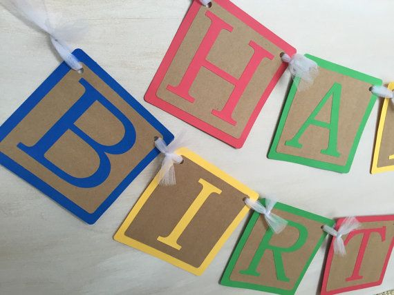 Having a Toy Story birthday party? Add this Toy Story banner to your party decorations. This amazing banner can also be used over & over again year after year because its theme neutral. Colorful colors w/ recycled Kraft brown paper strung with white tulle. These paper blocks resembles the alphabet blocks all kids love to play with. Woody from toy story even photo bombed the last photo! Each pennant is roughly 5 inches Happy is roughly 27 inches in length Birthday is roughly 43 inches in…